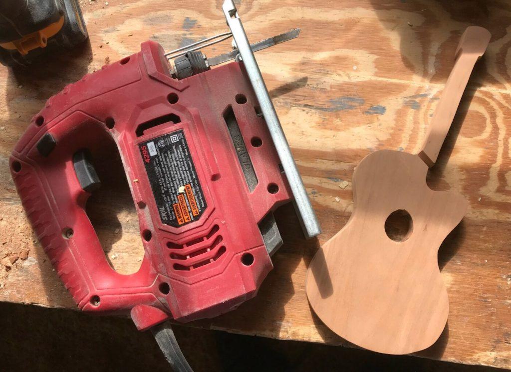 Cut scrap wood guitar in half