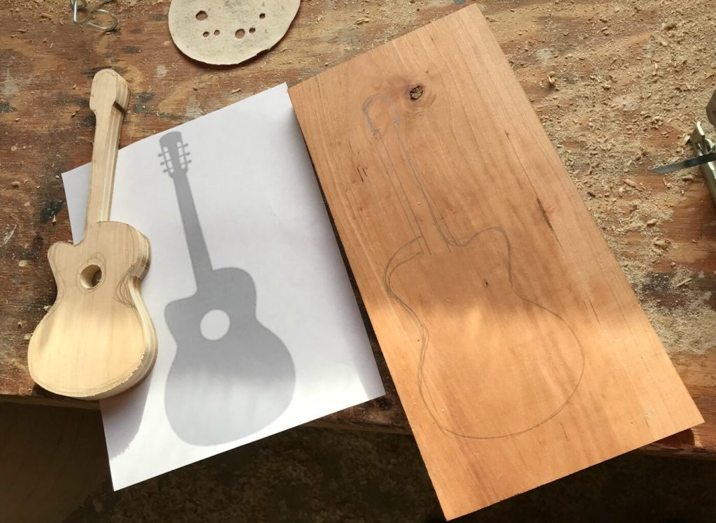 Scrap wood guitar template traced to cut