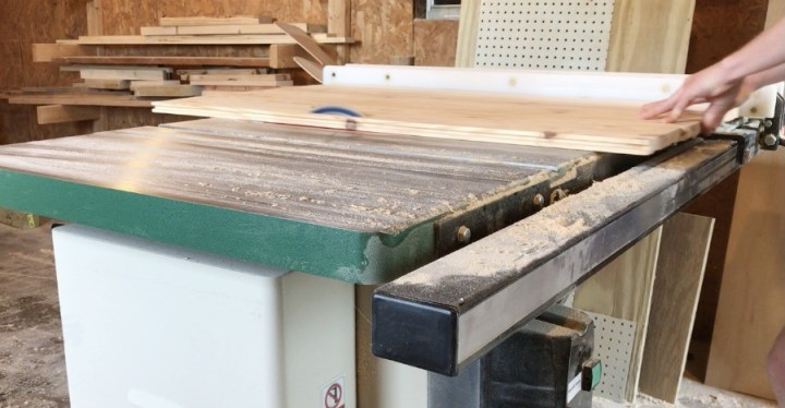 Trim DIY wooden stove top cover to correct size on table saw