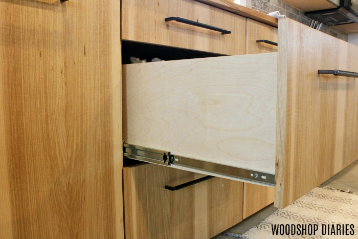 DIY kitchen cabinet with drawers open