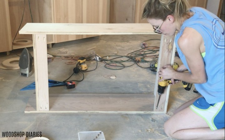 Shara Woodshop Diaries installing back supports onto upper kitchen cabinets