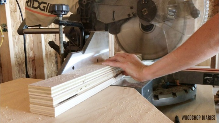 Shara Woodshop Diaries trimming cabinet support pieces on miter saw