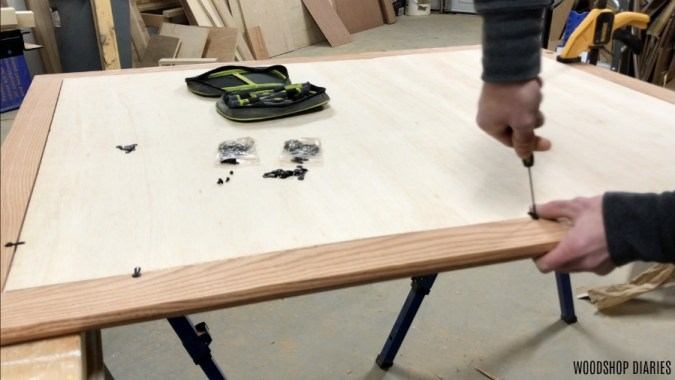 Attaching turn buttons onto back side of custom picture frame