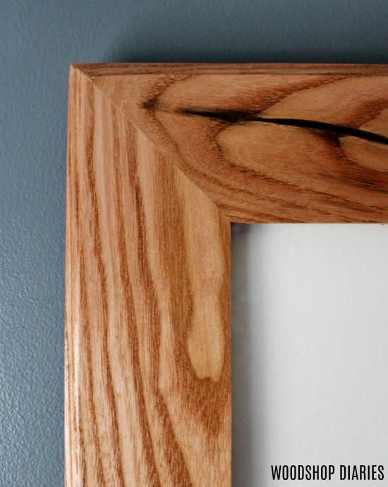 Close up of top corner of custom built frame using Kentucky Coffee wood