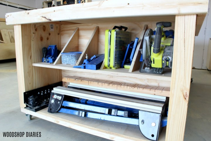 End of workbench storage cubby with divider panels for tools and jigs