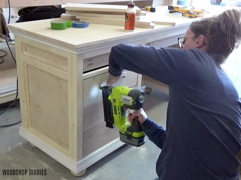 Nailing drawer fronts in place onto DIY storage desk