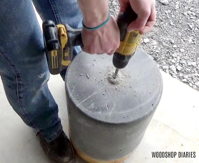 Drill draining hole in DIY concrete planter pot