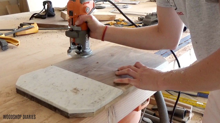 Using a trim router to chamfer the edge of a walnut serving platter