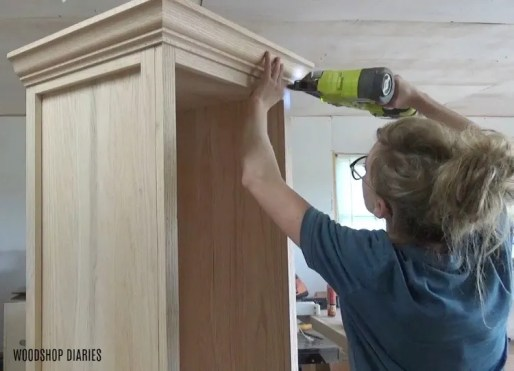 DIY linen cabinet nail on crown molding