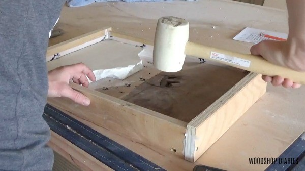 Place wood and marble into resin tray mold