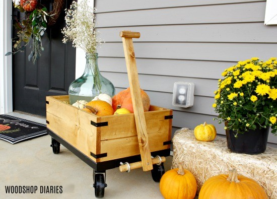 Display pumpkins in wooden wagon for a fun fall front porch idea