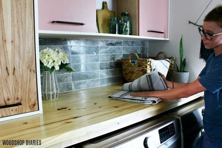 Folding laundry on butcher block counter top