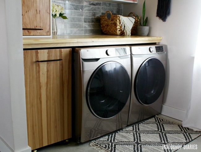 Small Laundry room with rolling laundry hamper cart