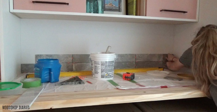 stick backsplash tile to the wall with mastic