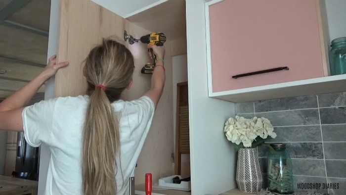 Attach hickory plywood door to cabinet