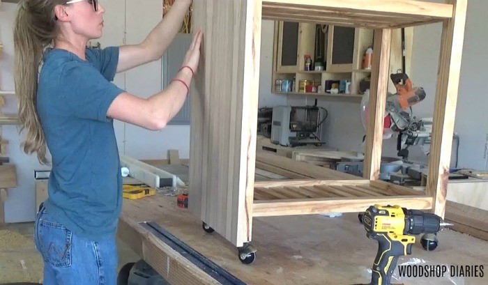 Attach plywood to front of bar cart for creative laundry room storage solutions