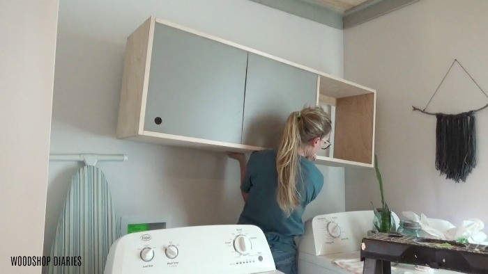 Remove old laundry room storage cabinet