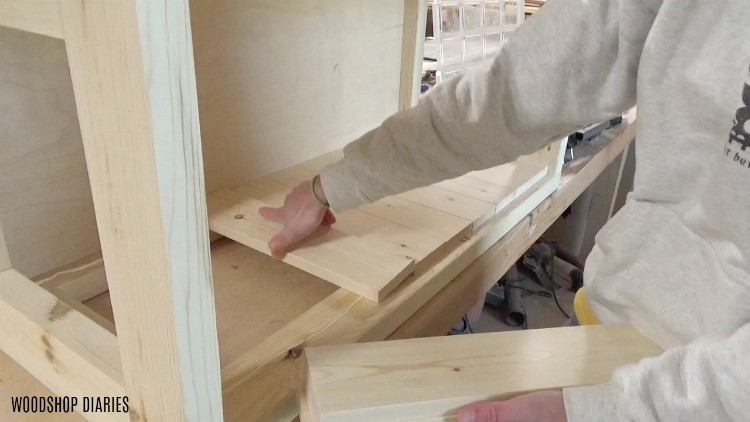 Place 1x4 slats along long side of hope chest frame
