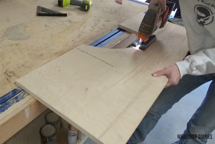 Using jig saw to cut middle section out of mobile lathe stand plywood top