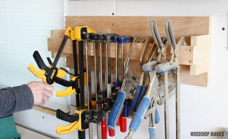 Close up of hanging clamps on DIY clamp rack