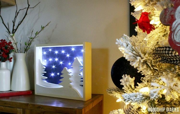 DIY Light Up Christmas Art display next to Christmas tree
