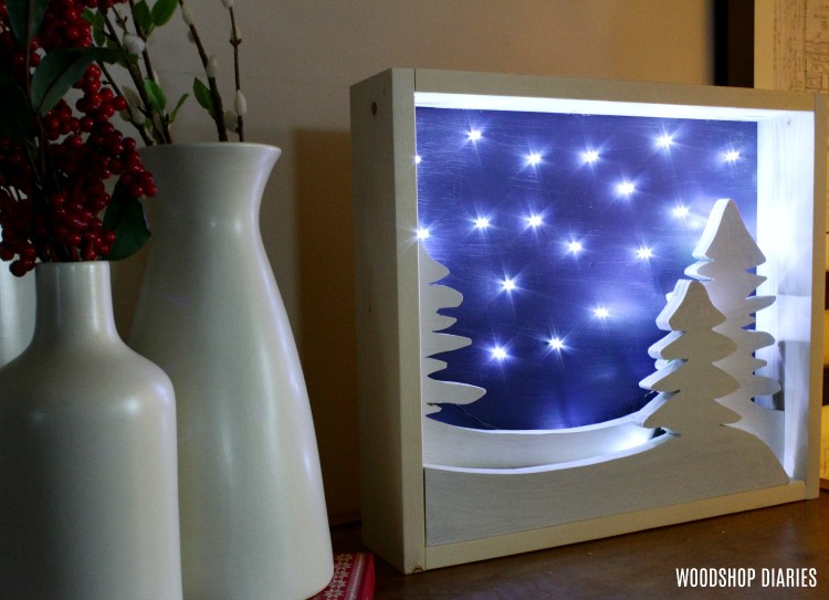 DIY Light Up Christmas Art with night sky and snow trees