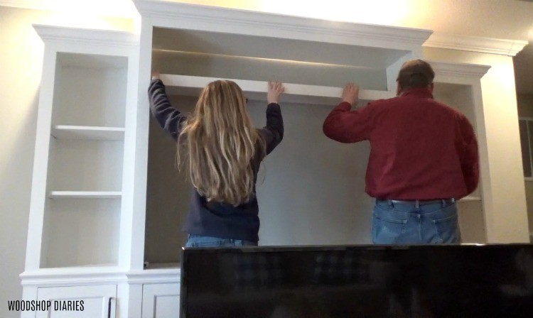 Shara and Dad installing shelves into Entertainment center