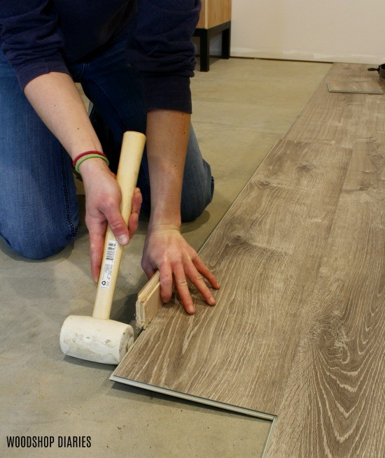 Tap vinyl planks int snapping lip to install