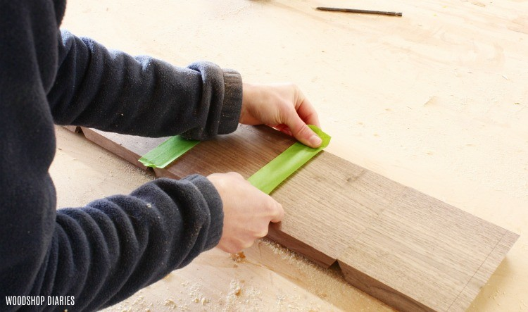 Apply painters tape to continuous grain boards to prepare for glue up