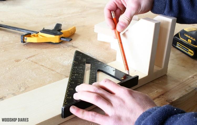 "draw 1 3/8"" space between pipe clamp rack divider blocks"