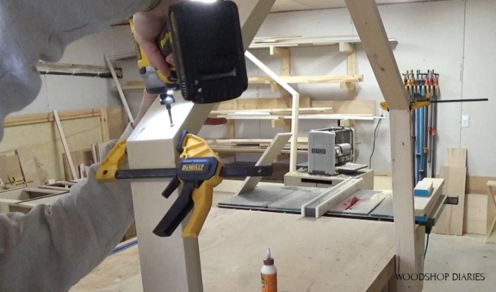 Attaching the roof top pieces of house bed