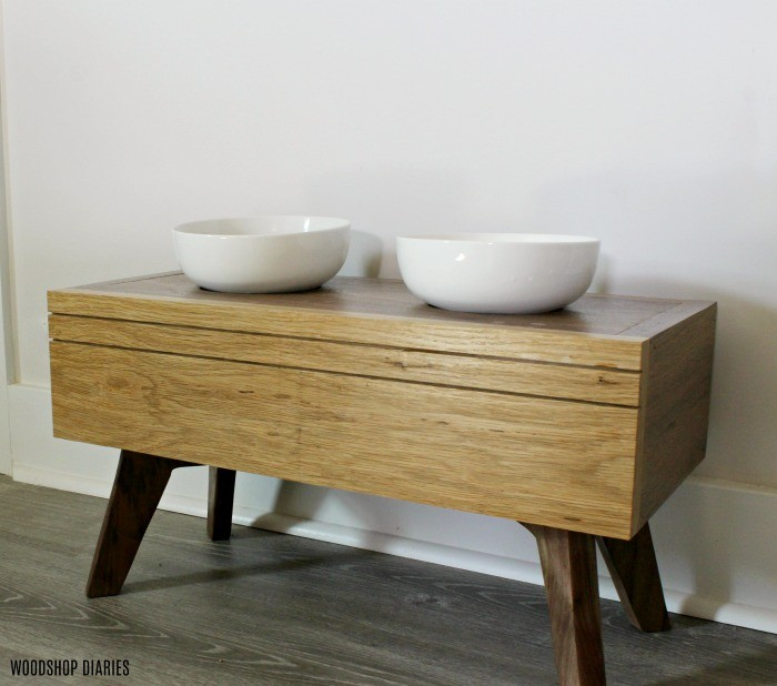 Simple DIY dog bowl stand with white bowls made from white oak and walnut wood