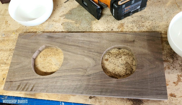 Holes cut in top board for placing food and water bowls into