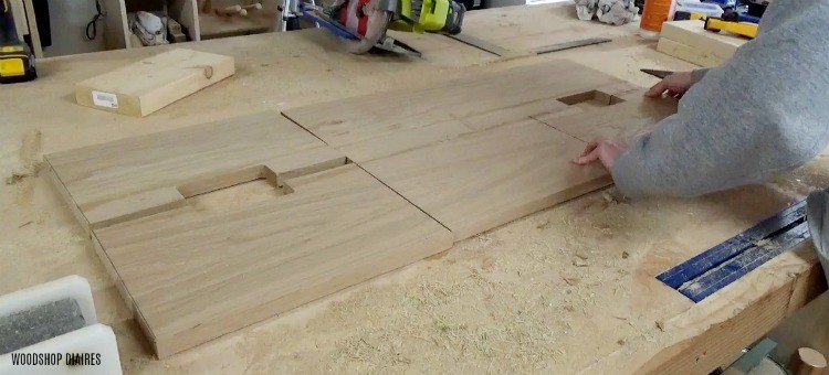 front pieces of vanity dresser laid out on workbench top