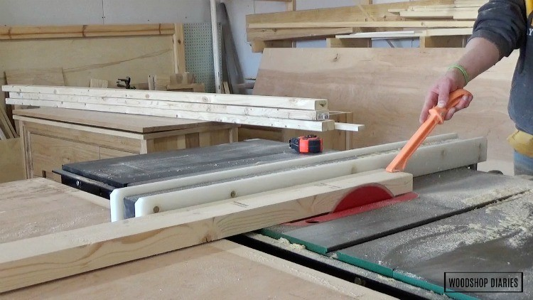 Running edge of 2x4 through table saw to clean up and square off edges