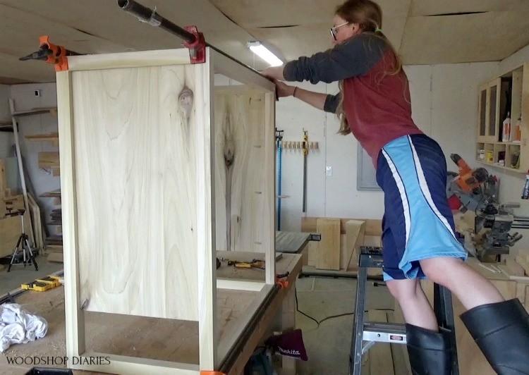 Shara on ladder clamping dresser frame together