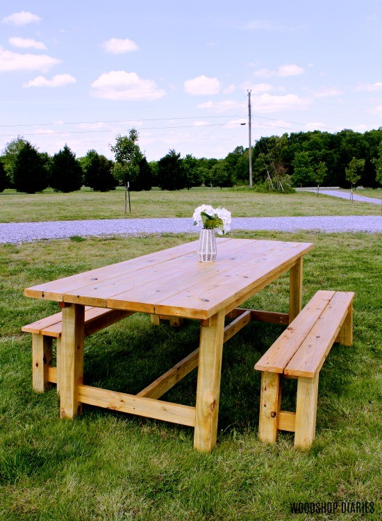 Trestle table and matching benches staged out in front yard