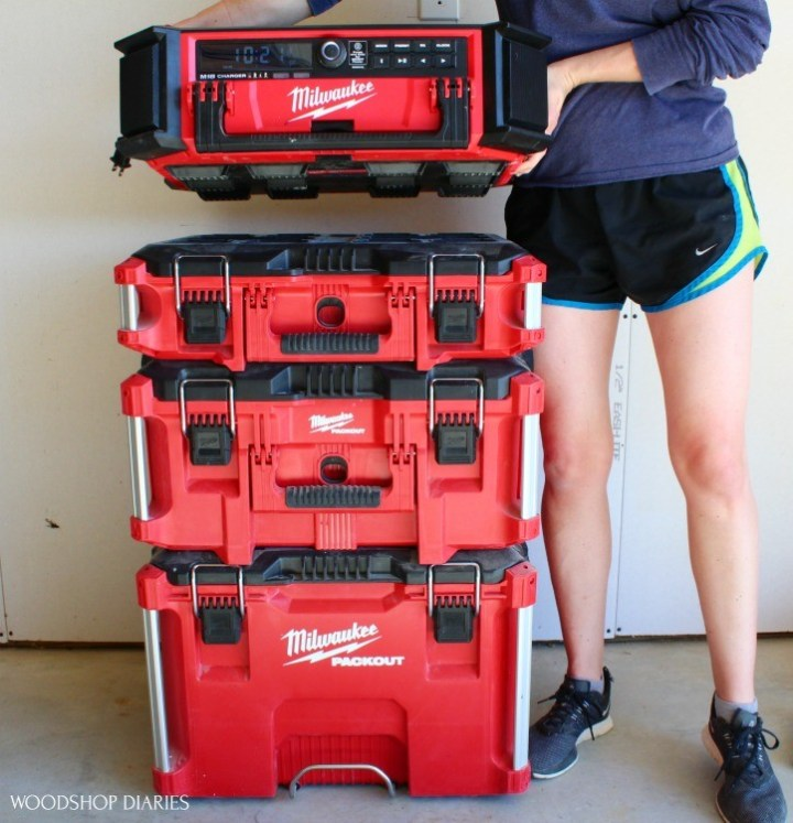 Shara lifting Packout stereo from PACKOUT storage system to show it's able to stand alone