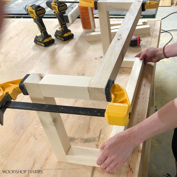 Towel rack assembly on workbench placing pieces before clamping