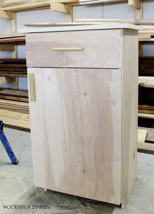 Finished cabinet with door and drawer hardware installed