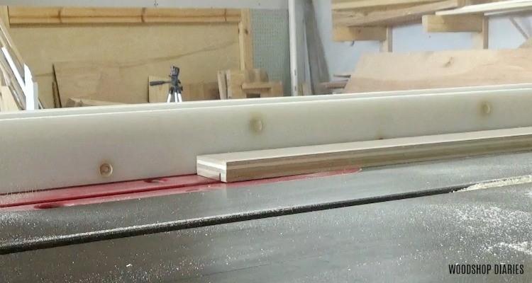 Cut dado in plywood mirror frame board on table saw
