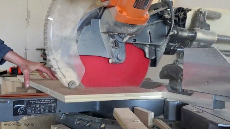 Use miter saw to trim plywood scraps for guitar stand stool build
