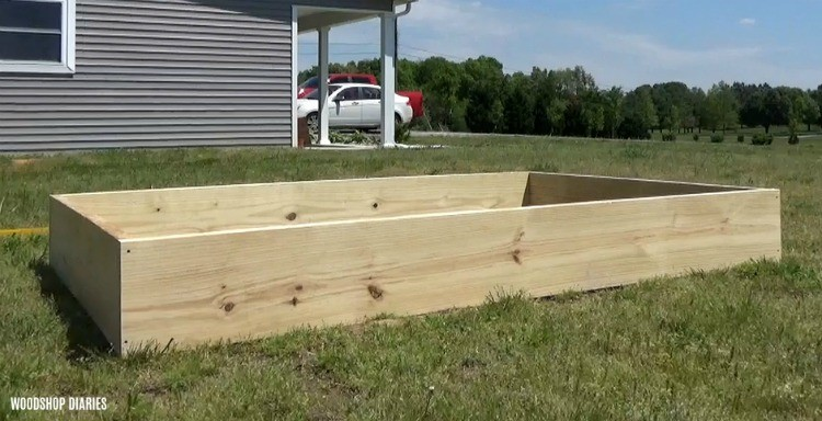 Simple garden bed box assembled in yard