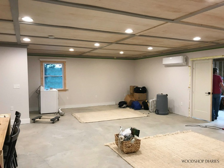 One room studio apartment with plywood ceiling installed