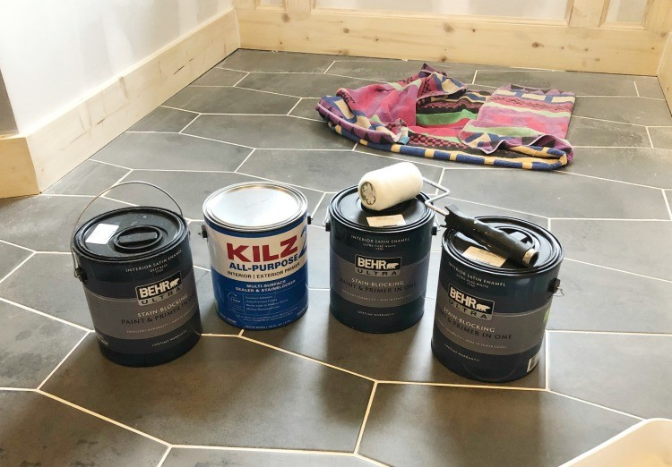 Behr Paint Cans ready to be opened and put to use on the bathroom walls