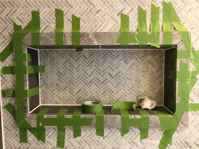 Tundra Grey tile framed out shower niche--FrogTape holding pieces in place
