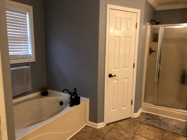Master bathroom before--tub and closet