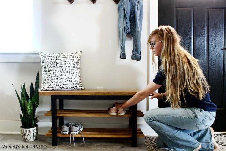 Shara Woodshop Diaries placing shoes into bench slat shelves