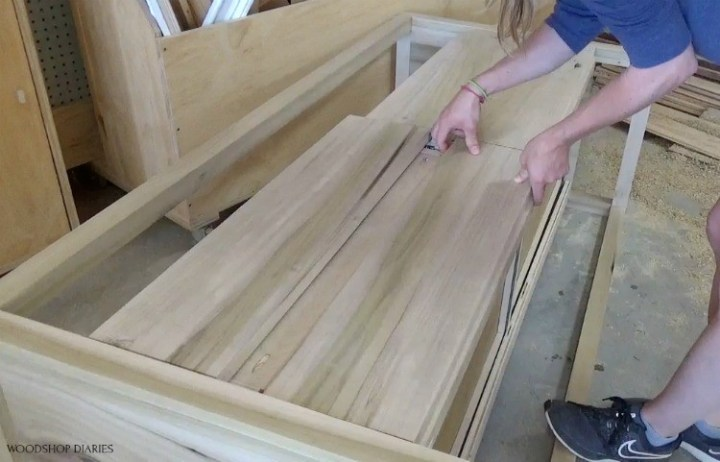Laying out drawer fronts to check spacing on dresser drawers