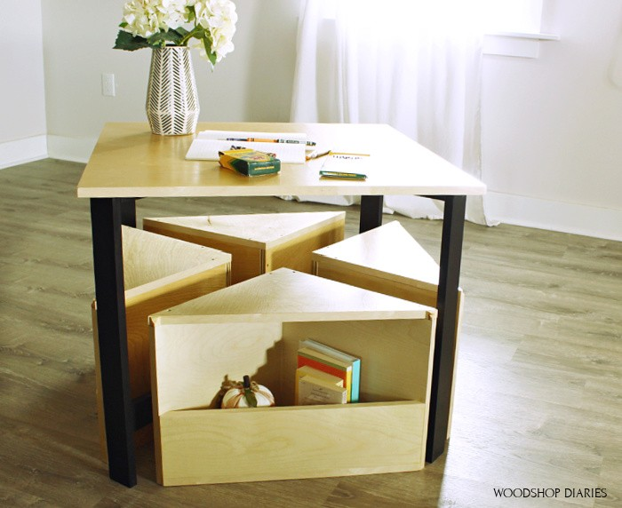 Kids nesting table with seats neatly tucked underneath